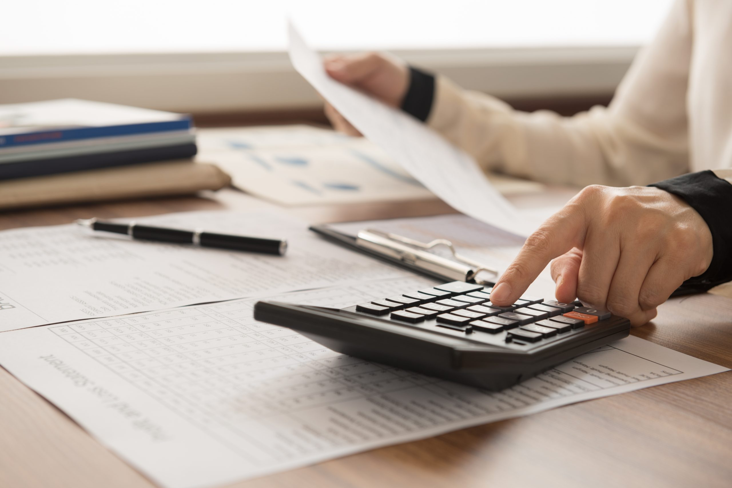 bookkeeper inspector calculated and checking balance account. accounting and auditing concept.