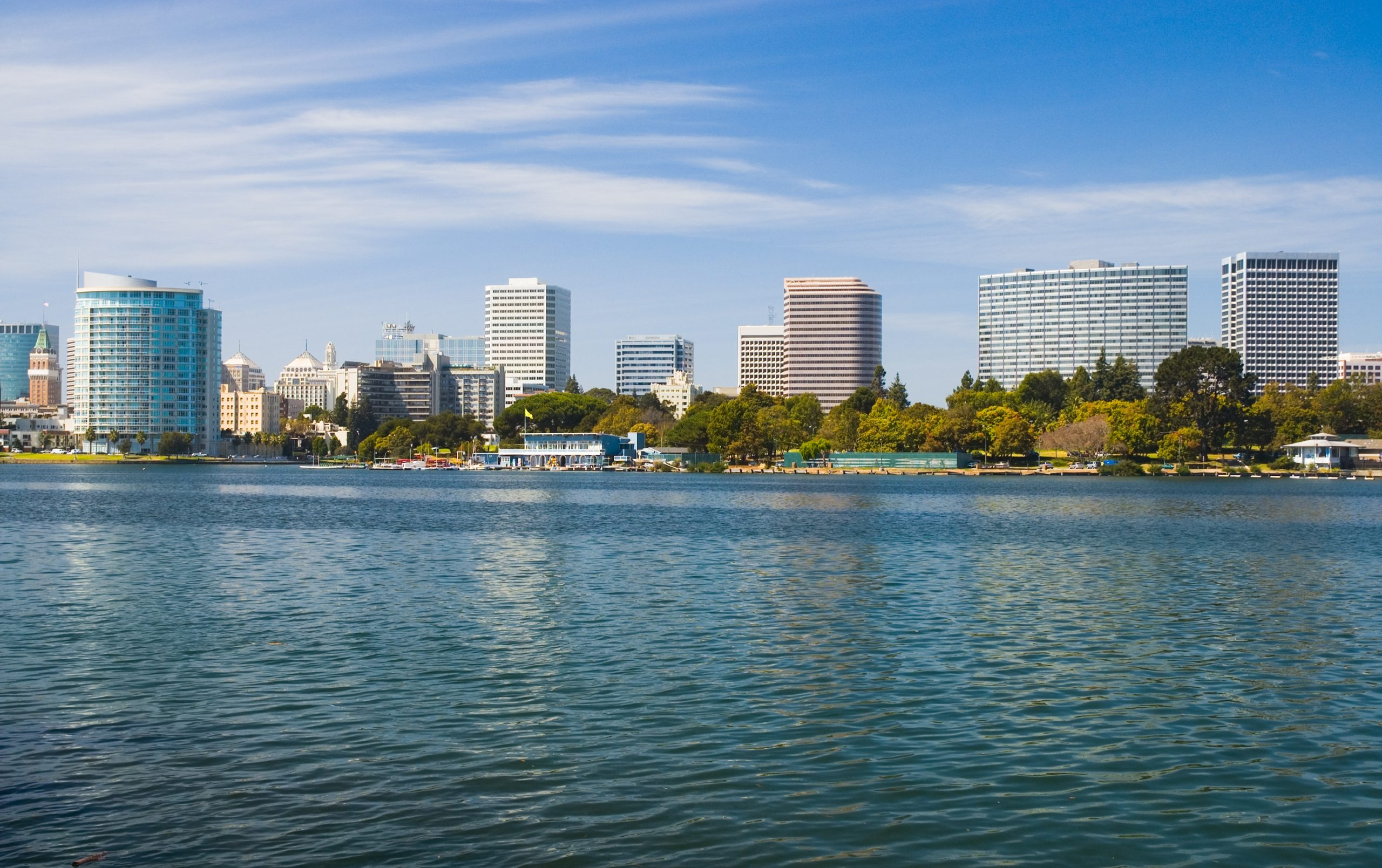 Oakland Downtown skyline with Lake Merritt in the foreground.