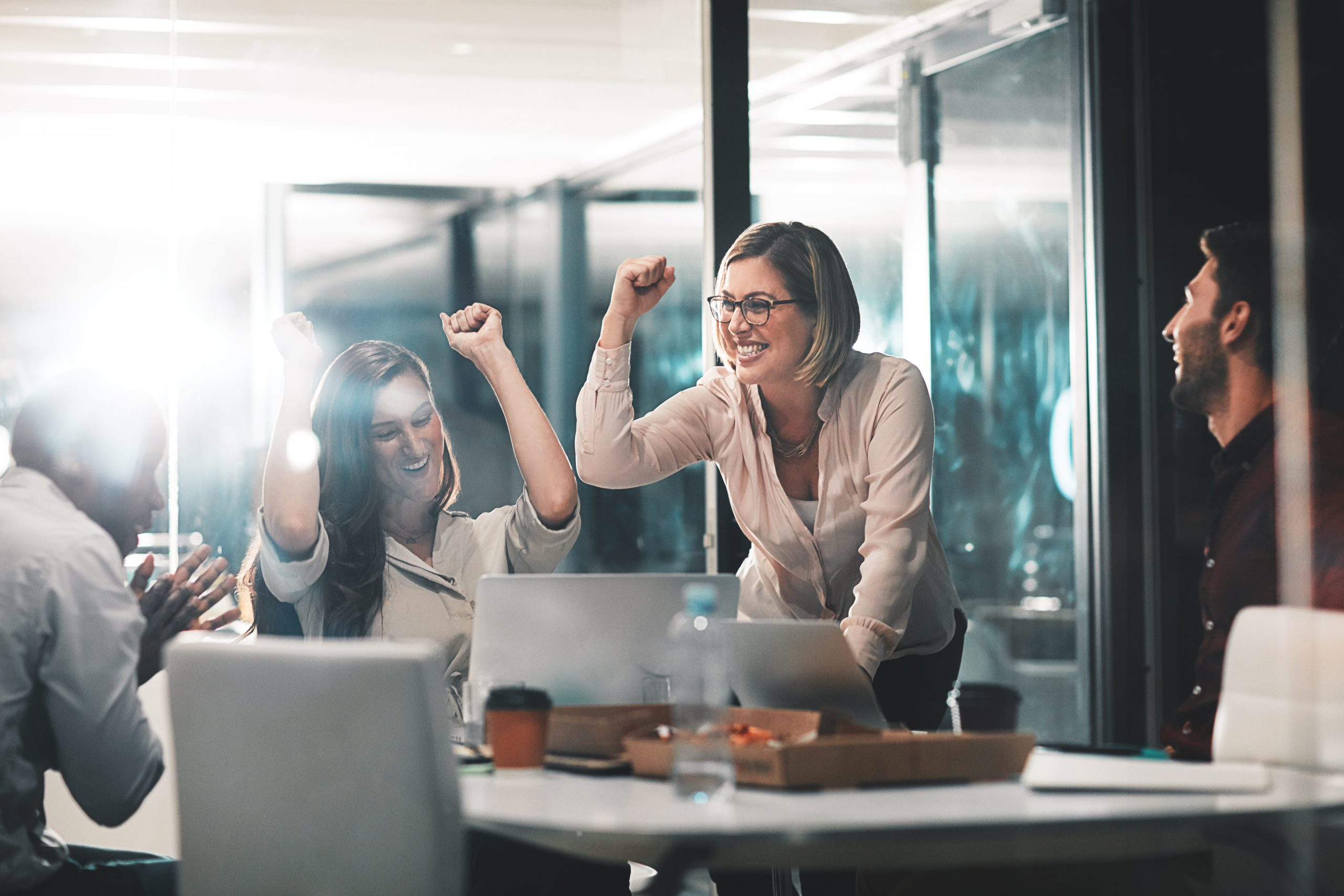 Shot of colleagues celebrating during a meeting in a modern office